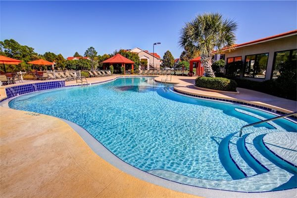 Resort Style Pool with Waterfall at Fairfield Lakes Apartments in Pensacola FL