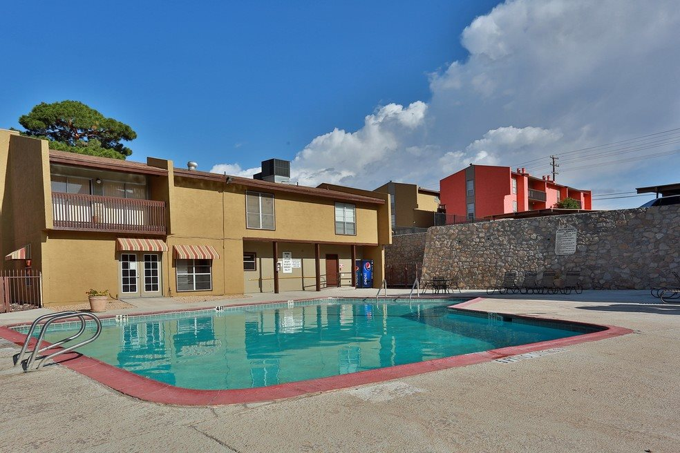 Large Swimming Pool with Lounge Chairs at Mountain View at Southgate Apartments in El Paso, TX 79925