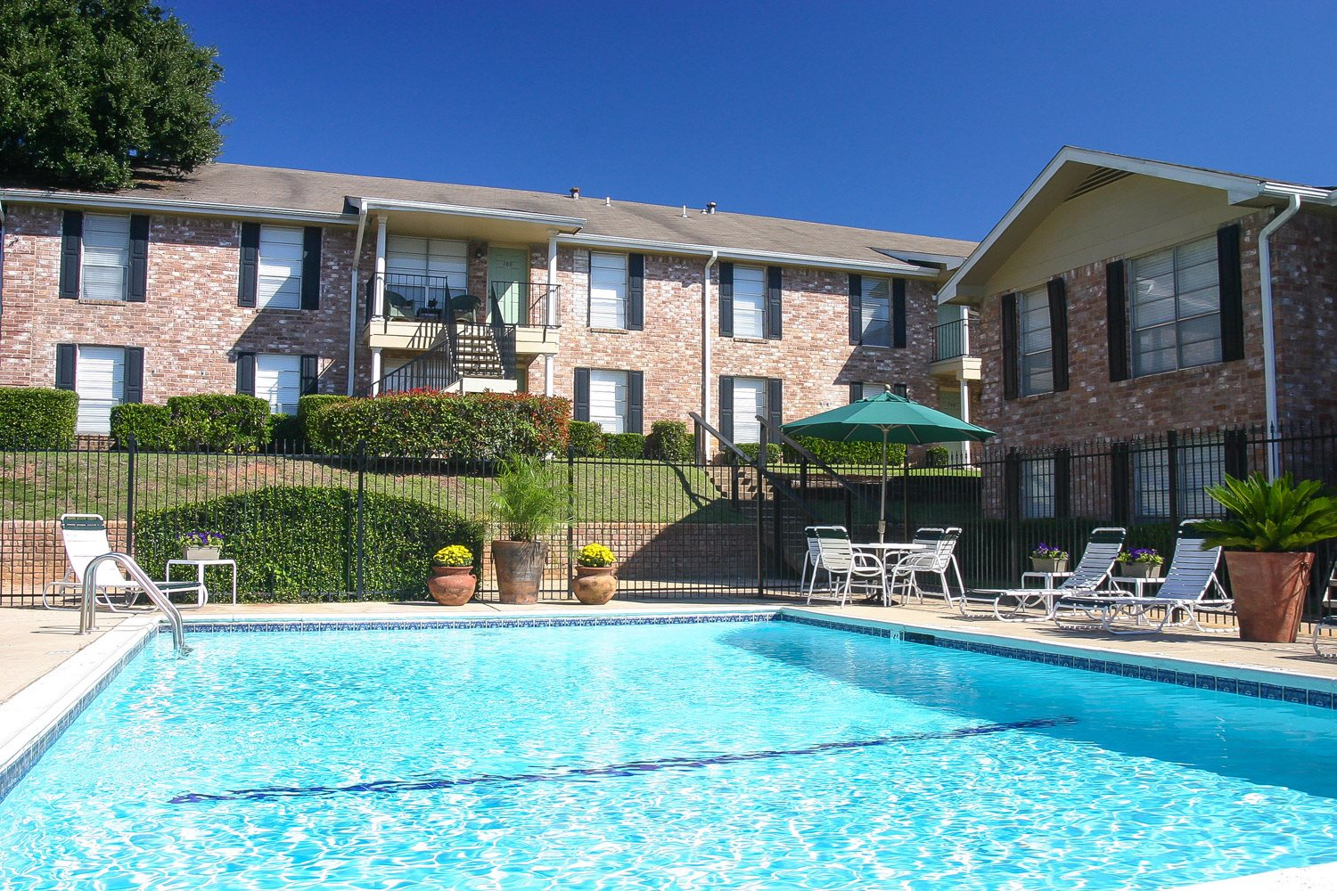 Swimming Pool Photo at Woodhollow Apartments in Huntsville , TX 77340