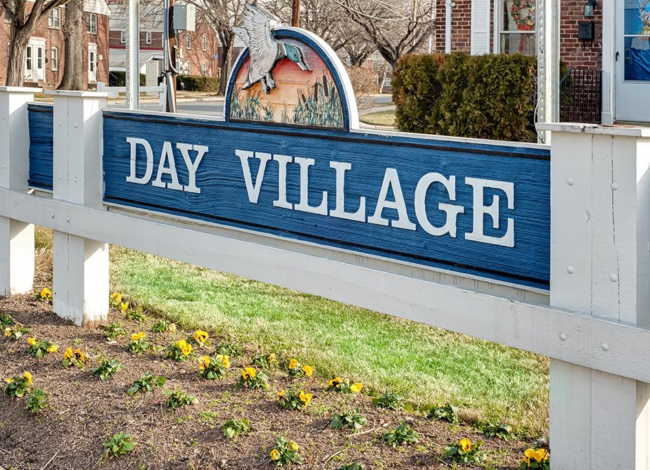 Property sign at the entrance of Day Village Townhomes, Dundalk, MD,21222