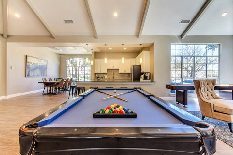 Resident lounge with on-site pool table and full entertainment kitchen for resident use