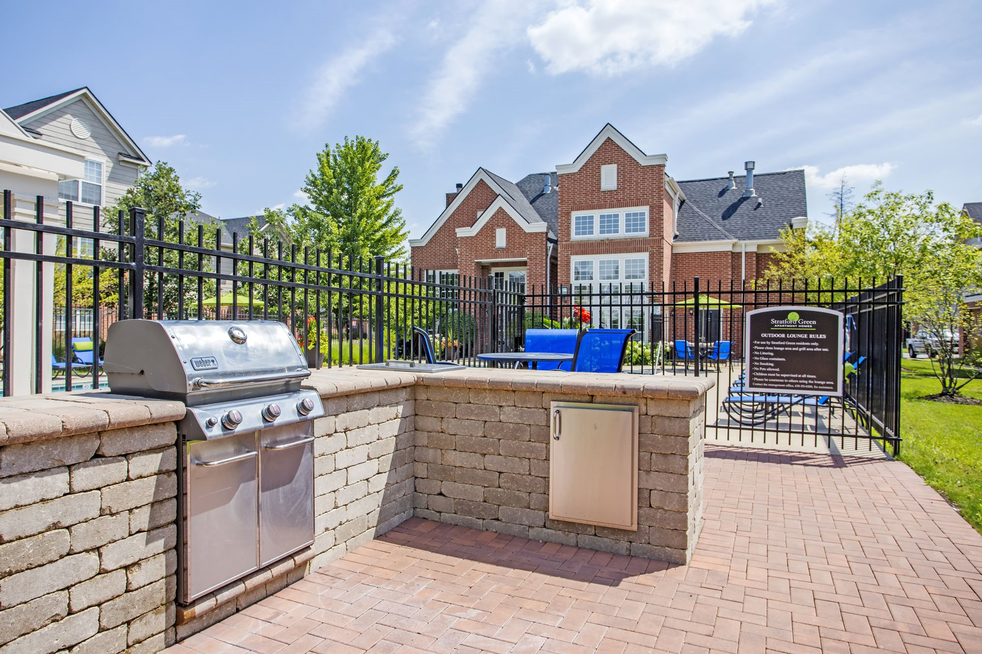 outdoor kitchen with stainless steel Weber grill