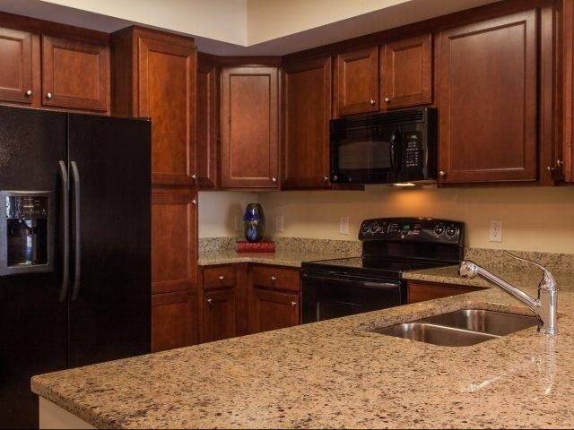 A chef's delight - granite countertops and custom cherry cabinetry, at Windsor at Brookhaven, GA 30319
