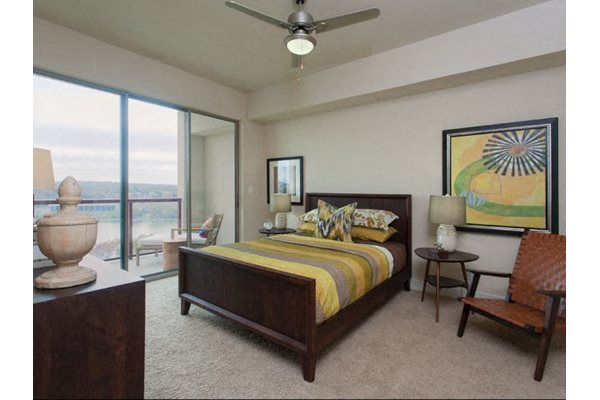 Private Master Bedroom With Oversized Windows at Windsor on the Lake, 43 Rainey Street, TX 78701