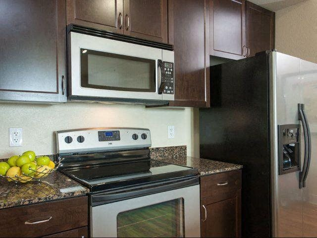 Gorgeous, silver finished appliances and granite countertops at Windsor on the Lake, Austin, TX
