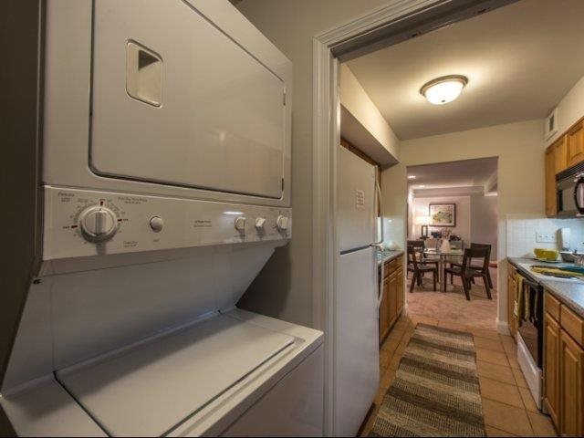 One bedroom pantry includes in home washer/dryer and extra storage space