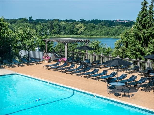 Outdoor seasonal pool with expansive sundeck and water views!