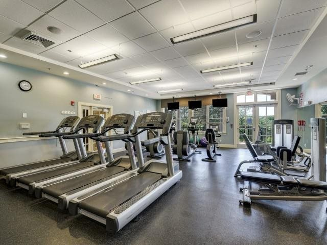 24 hour fitness center includes Wi-Fi, free weights,..