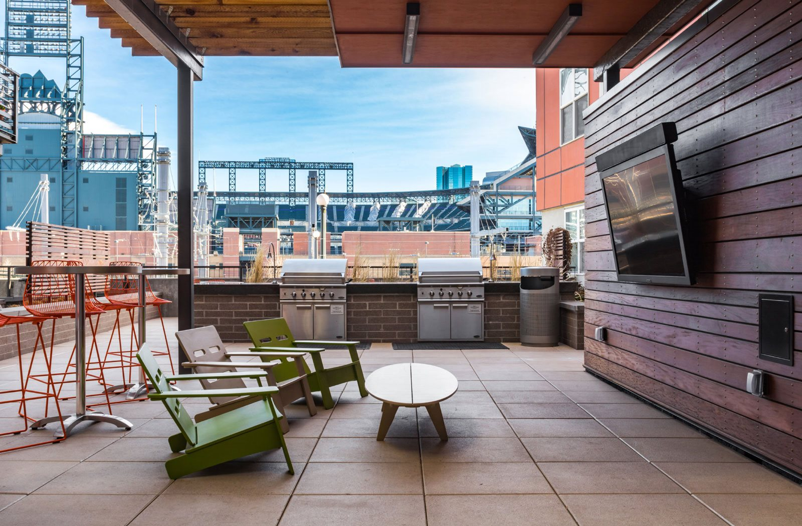 outdoor plaza courtyard with fireplace and covered sitting area at the casey 2100 delgany
