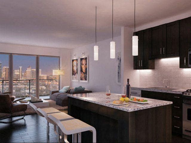 Gourmet kitchens with granite countertops and island kitchens., at The Sovereign at Regent Square, TX