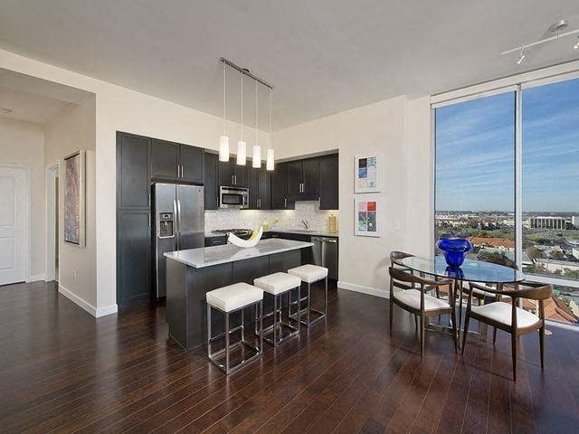 Designer cabinetry, plank wood flooring and energy star appliances, at The Sovereign at Regent Square, 3233 West Dallas, Houston, TX
