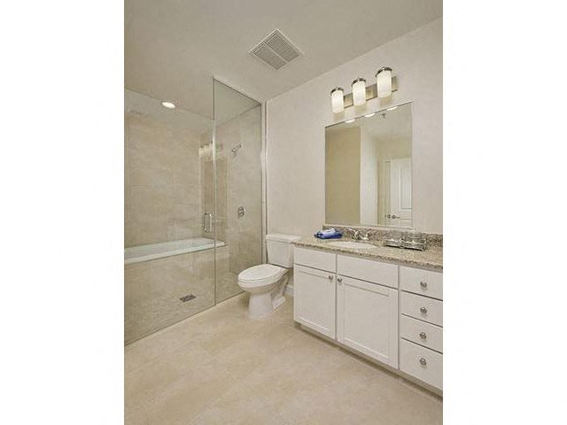 Custom bathrooms featuring water conserving plumbing fixtures, at The Sovereign at Regent Square, 3233 West Dallas, Houston