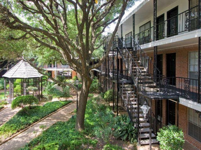 Lush landscaped courtyards At Allen House Apartments,3433 West Dallas Street, 77019