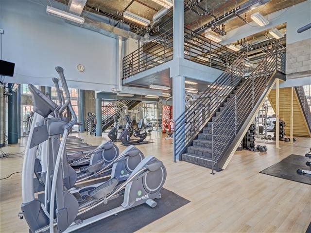 Our bi-level fitness room has free weights, cardio equipment and space for yoga.