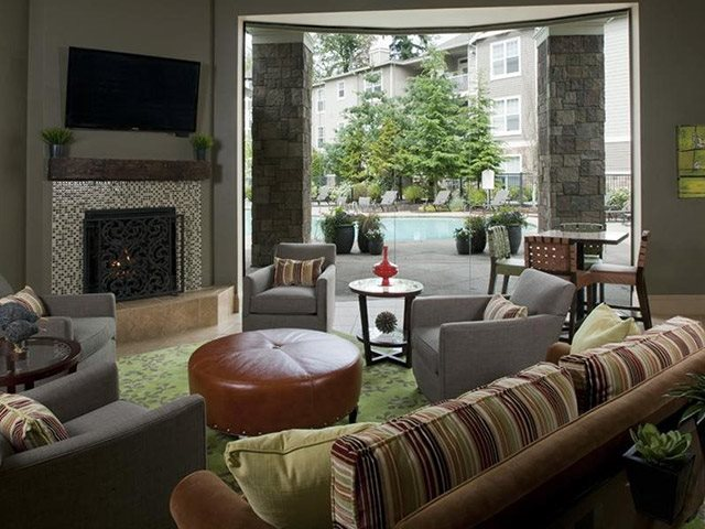 The Estates at Cougar Mountain, Issaquah, WA,98027 has Resident Clubroom with Fireplace, TV