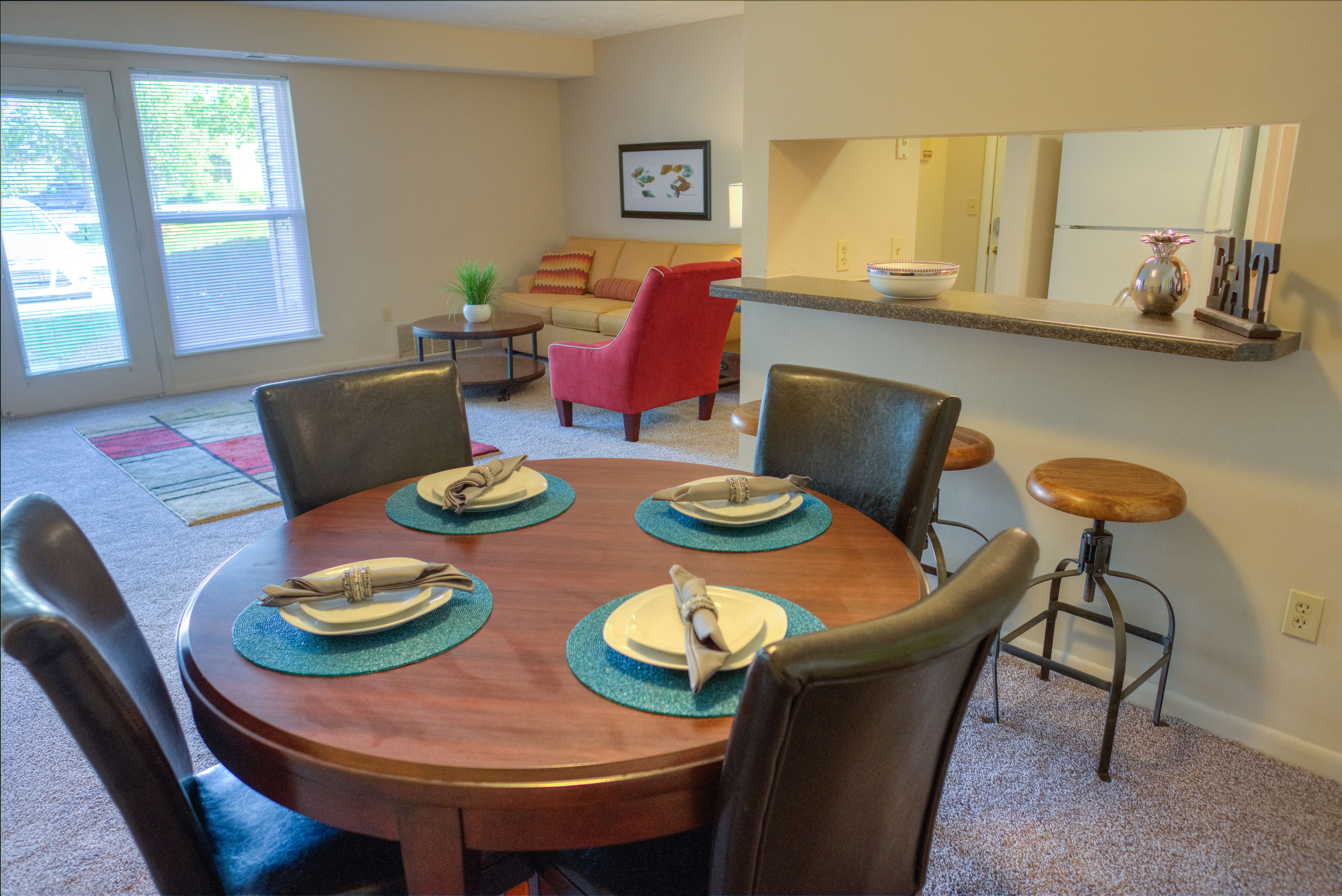 Dining Area Open to Living Space at Pine Lane Estates Apartments