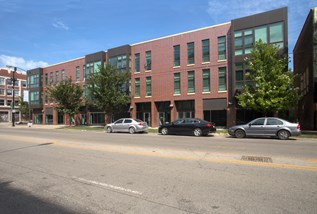 Exterior image of one of the Park Boulevard IIB buildings, plus surrounding neighborhood