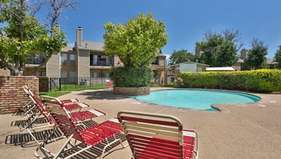 Pool lounging area at Country Club Villas is Amarillo, TX