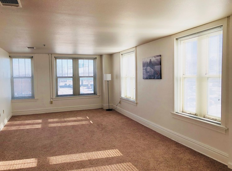 Spacious living area at LeClaire Apartments in Moline, IL