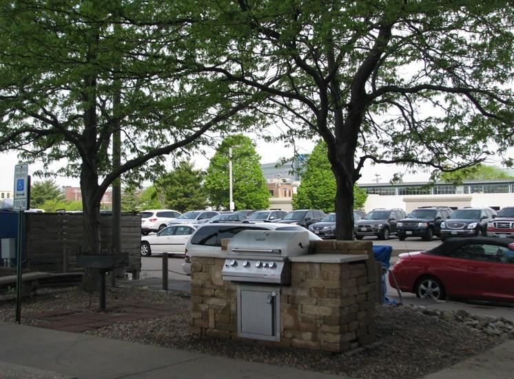 bbq picnic area at LeClaire Apartments in Moline, IL