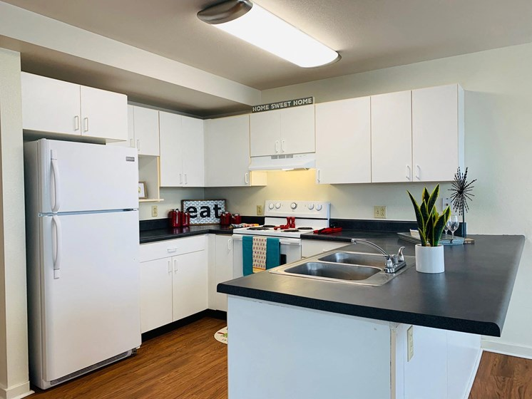 Spacious Kitchen at LeClaire Apartments in Moline, IL