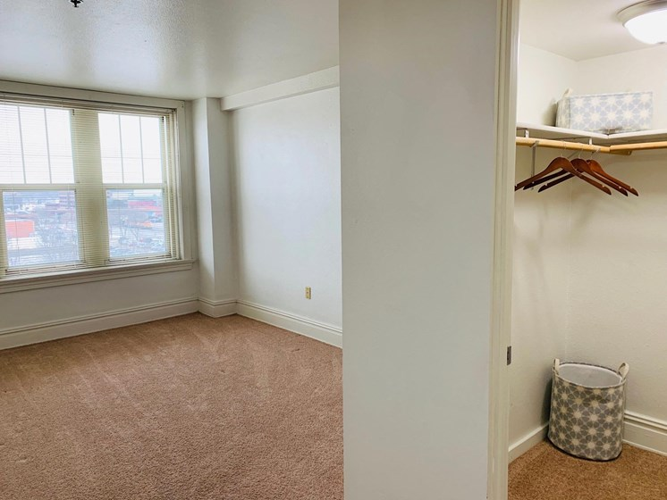 Bedroom with Walk-in Closet at LeClaire Apartments in Moline, IL