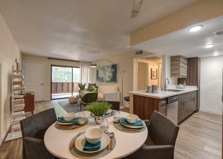 Luxury Apartment Community Dining Area with View of Kitchen and Living Room
