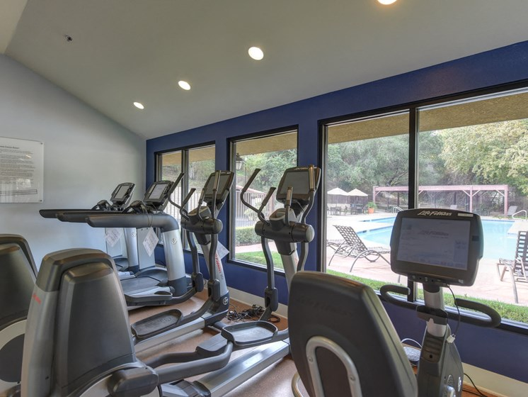 Luxury Apartment Community Fitness Center with Cardio Machines and Free Weights