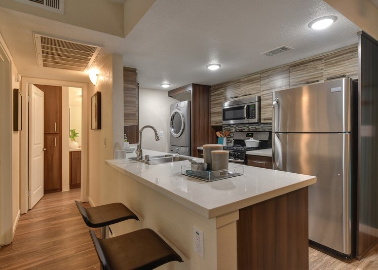 Luxury Apartment Community Kitchen with In Unit Washer Dryer and View of Hallway