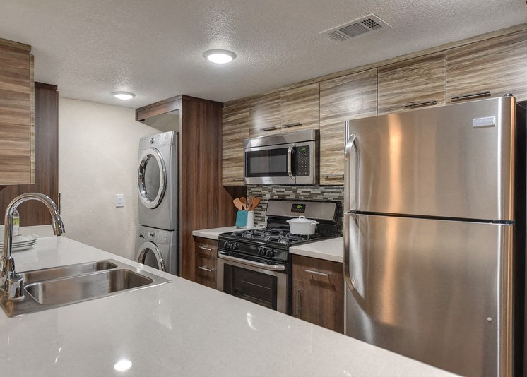 Luxury Apartment Community Kitchen with View of In Unit Washer and Dryer