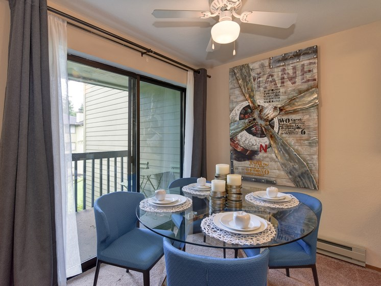 Dining Area with View of Private Patio, Blue Chairs, Ceiling Fan/Light