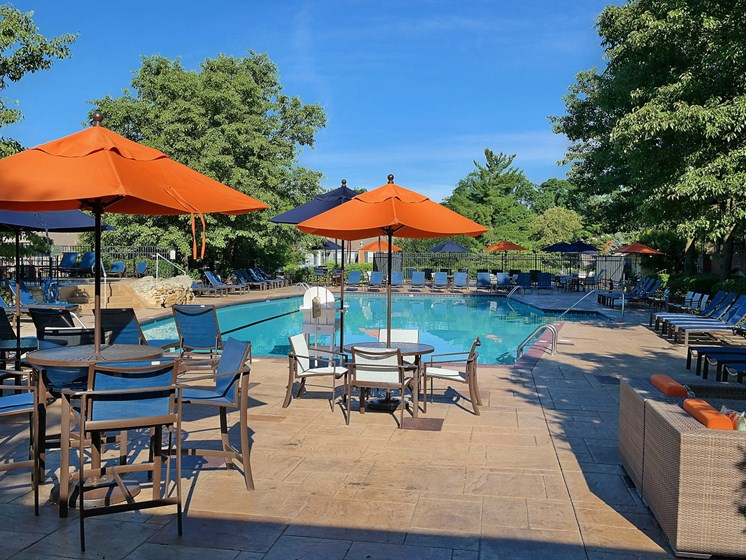 Umbrella Shaded Chairs By Pool at Indian Creek Apartments, Cincinnati, OH