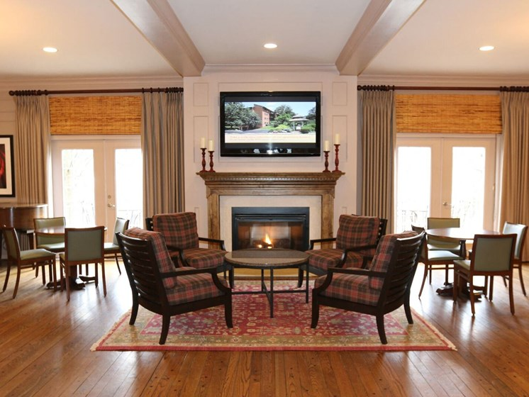 Club Room With Large Screen Tvs And A Fireplace at Indian Creek Apartments, Cincinnati, OH