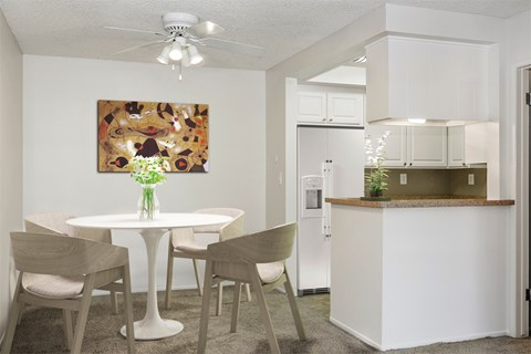 One bedroom dining room area with a view of the kitchen