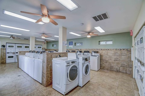 Laundry Room with dryers on both sides and washers in the center of the room