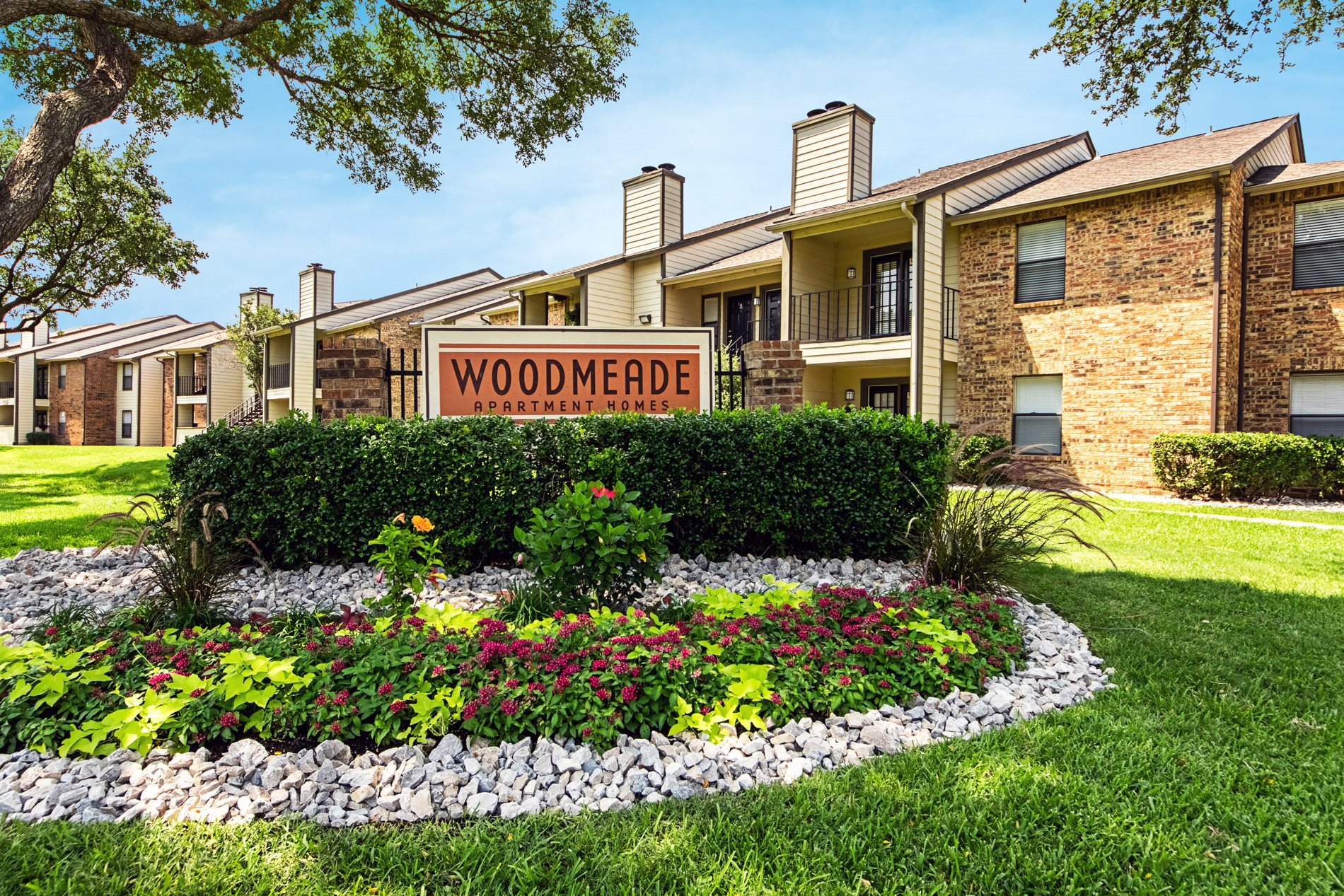 Front Signage at Woodmeade Apartment Homes in Irving, Texas, TX
