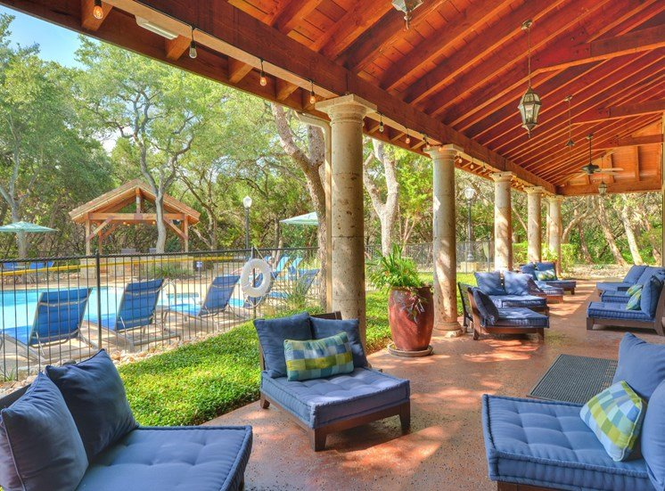 Outdoor Pool Seating at Nalle Woods Apartments in Austin, Texas