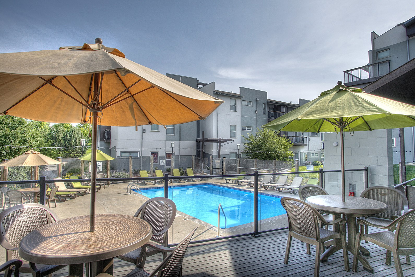 Poolside Umbrellas and Dining Tables at Briar Hills, Omaha