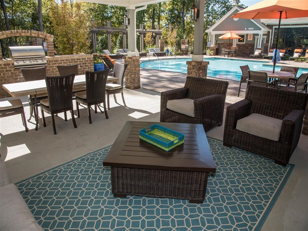 poolside grilling station and outdoor seating