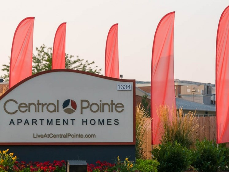 Front sign with flags at Central Pointe Apartments in Boise ID