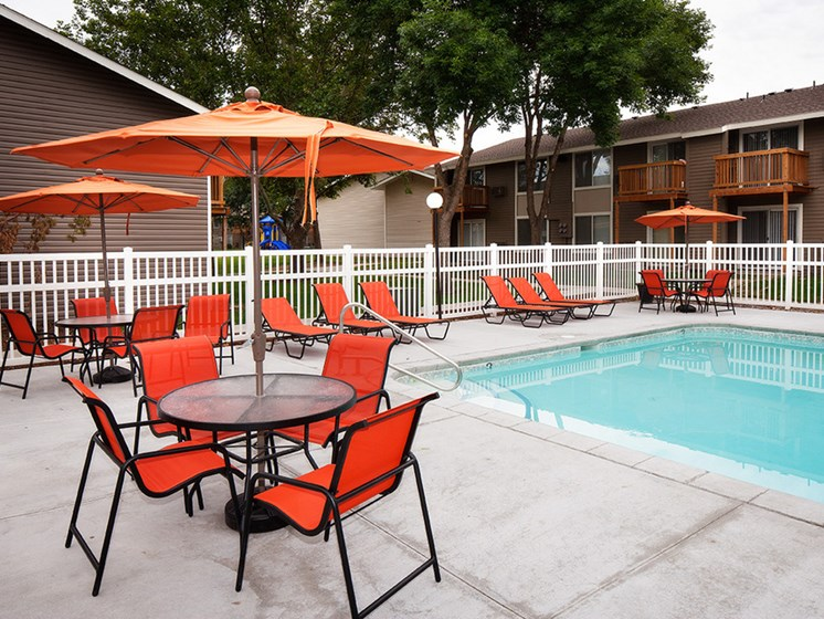 sitting area next to pool Central Pointe Apartments in Boise ID