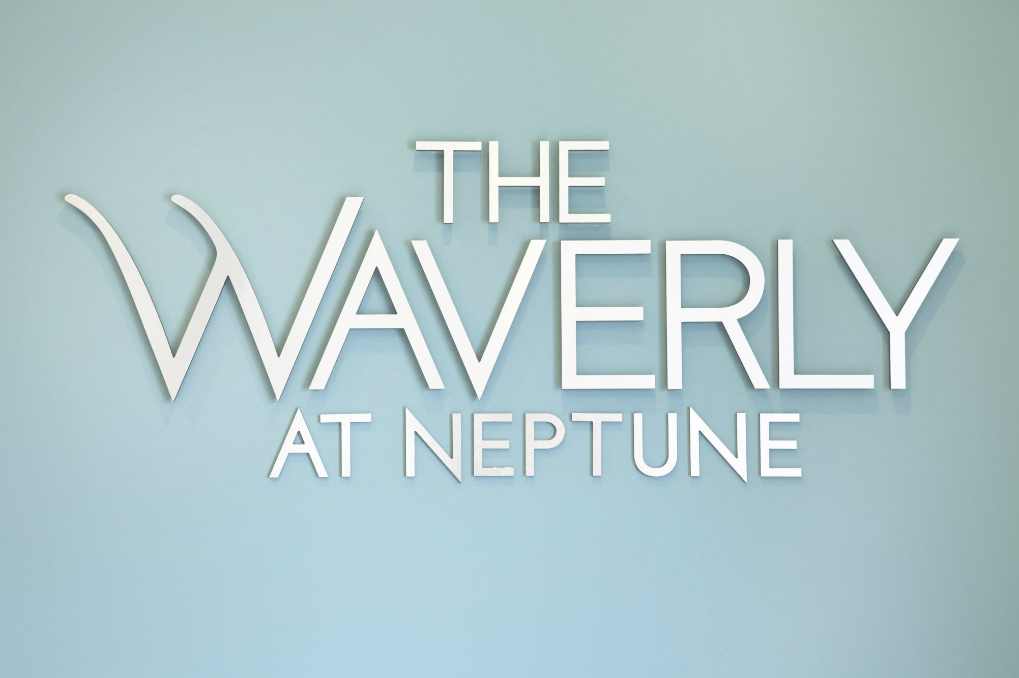 The Waverly at Neptune Clubhouse wall logo