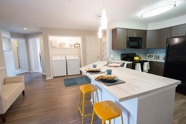Fully equipped kitchen attached with Eat-in bars