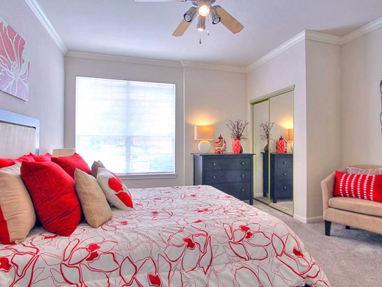 Bedroom With Large Window And Ceiling Fan at The Bridges on Eldridge, Houston
