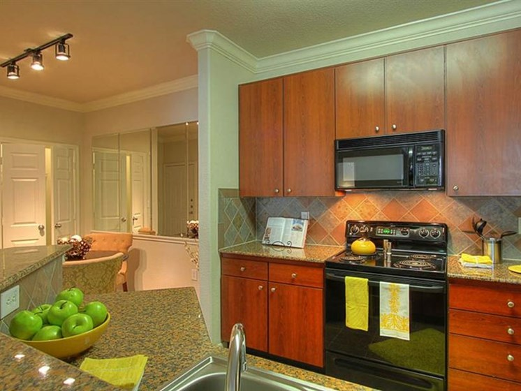 Cherry Cabinetry and Black Appliance Package