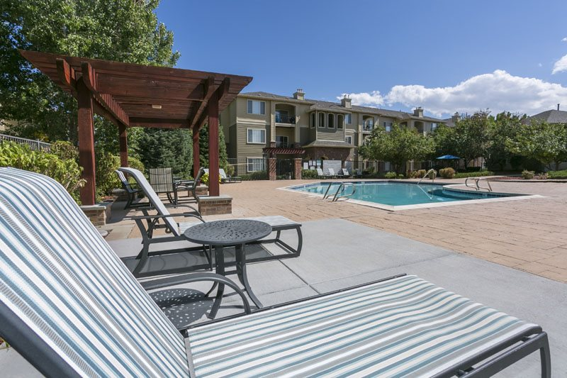 Swimming Pool with Lounge Chairs at Ranchstone, Parker, CO,80134