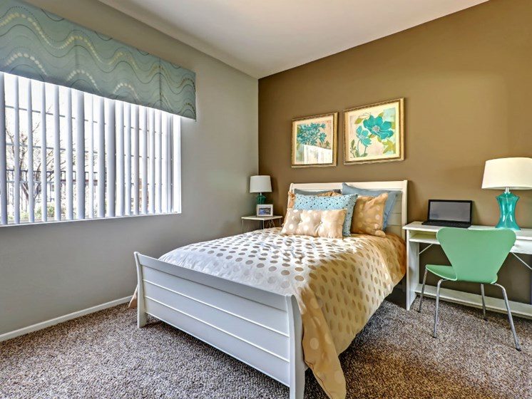 Live in cozy bedrooms at Ranchstone Apartments, 17125 E Carlson Drive, Parker, CO 80134