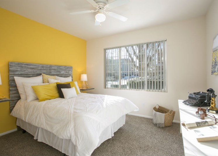 Comfortable Bedroom with Yellow Accents