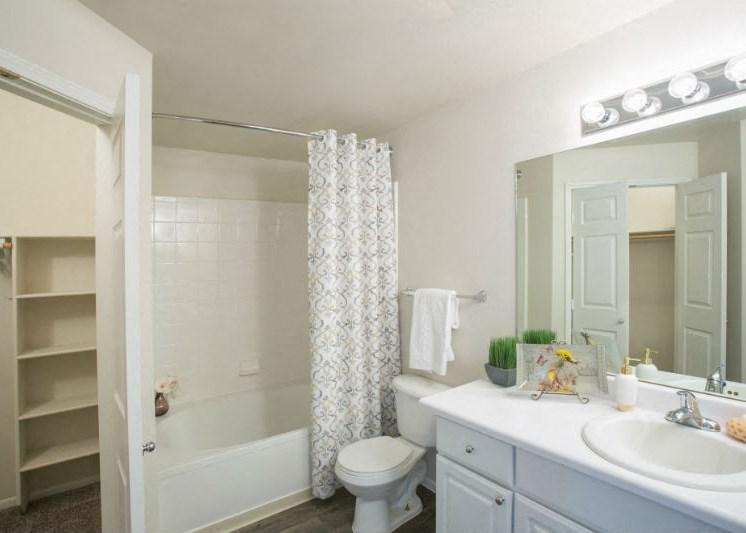 Spacious Bathroom with Bath Tub and Big Mirror