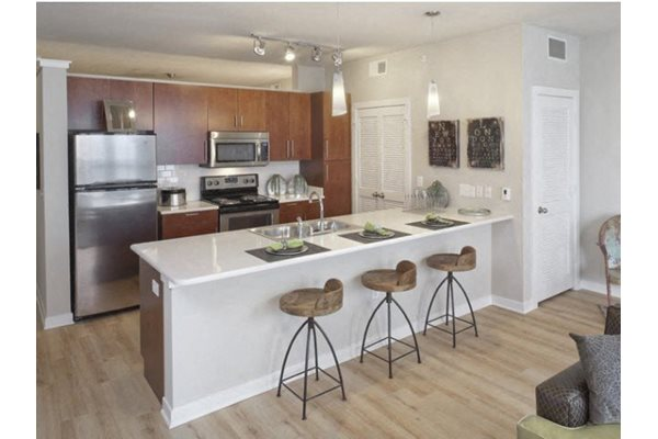 Spacious Kitchen with Stainless Silver Appliances at The Can Plant Residences at Pearl, San Antonio, TX